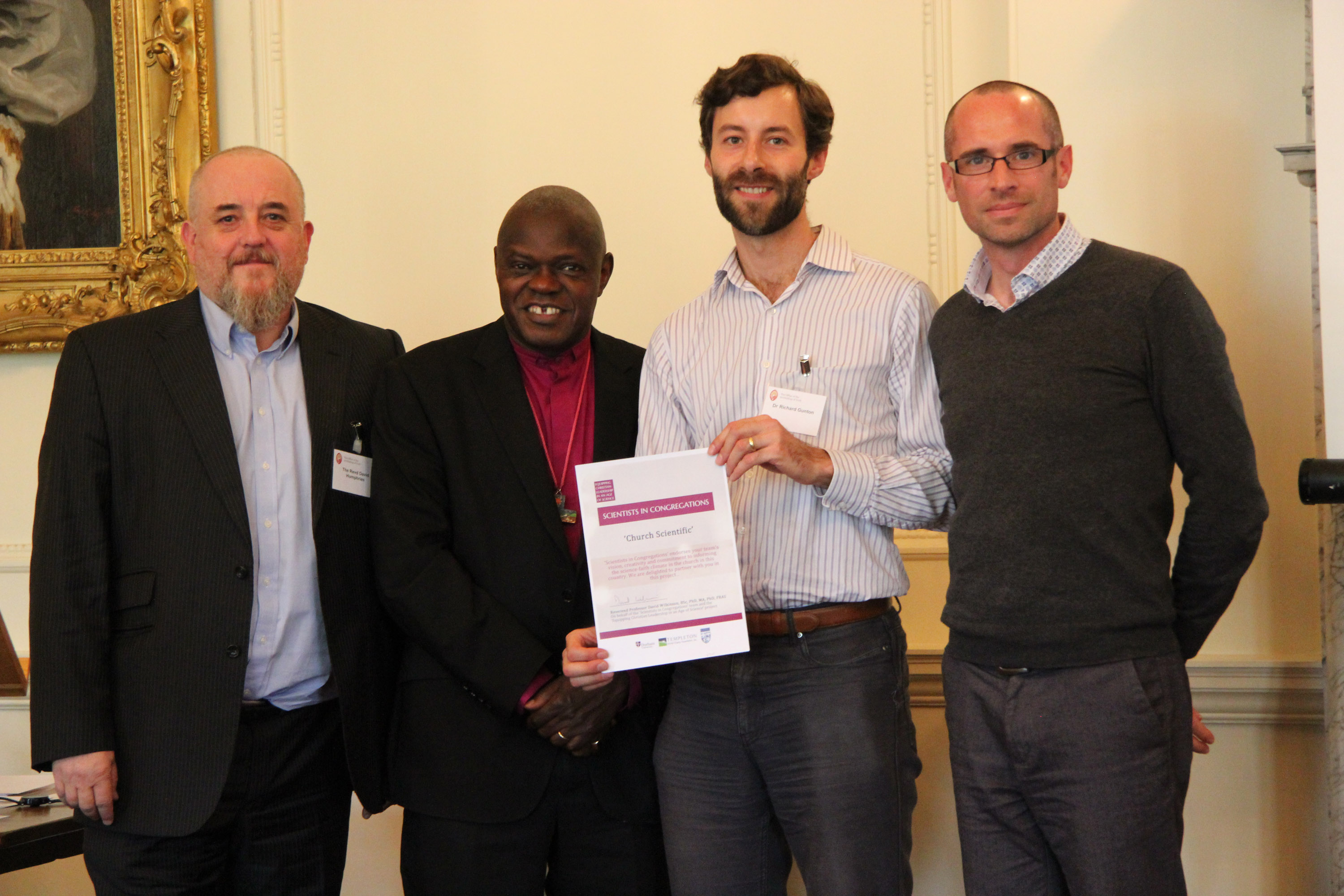 Church Scientific team receiving certificate from Archbishop John